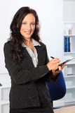 Beautiful smiling woman at work with clipboard Royalty Free Stock Photos