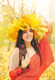Beautiful smiling woman with wreath of maple leaves on a head Stock Photography