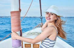 Beautiful smiling woman on a yacht Stock Images