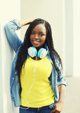 Beautiful smiling young african woman with headphones Stock Photography
