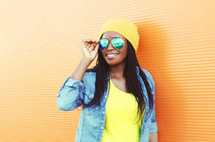 Beautiful smiling young african woman wearing a sunglasses Stock Photos