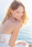 Beautiful smiling young bride woman near the sea Stock Images
