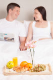 Beautiful smiling young couple having breakfast. Royalty Free Stock Images