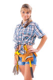 Beautiful smiling young female construction worker on white Royalty Free Stock Image
