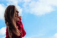 Beautiful smiling young girl, against a sky Royalty Free Stock Photography