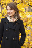 Beautiful smiling young girl in an autumn park Stock Photography