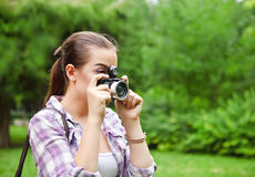 Beautiful smiling young girl with camera Royalty Free Stock Images