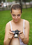 Beautiful smiling young girl with camera Stock Photos