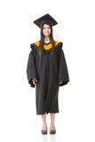 Beautiful smiling young graduation woman standing. Stock Photos