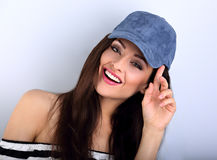 Beautiful smiling young make-up model with brown hair posing and Royalty Free Stock Photo
