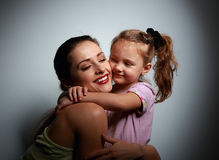Beautiful smiling young mother cuddling her cute daughter Royalty Free Stock Photography