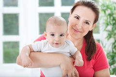Beautiful smiling young mother with her baby Royalty Free Stock Photo