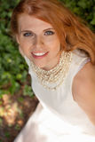 Beautiful smiling young redhead woman portrait outdoor. In summer Royalty Free Stock Photography