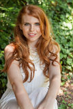 Beautiful smiling young redhead woman portrait outdoor Royalty Free Stock Photo