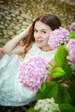 Beautiful smiling young woman in Alfabia gardens royalty free stock photo