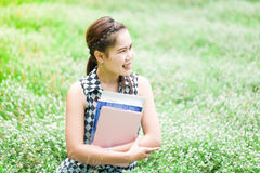 Beautiful smiling young woman with book Royalty Free Stock Images