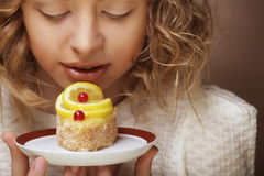 The beautiful smiling young woman with a cake Stock Photography