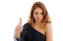 Beautiful smiling young woman close-up raises thumbs up, isolate Royalty Free Stock Image