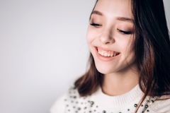 Beautiful smiling young woman closeup. Happy girl laughing on white background. Positive emotion. stock photos