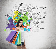 Beautiful smiling young woman with the colourful shopping bags from the fancy shops. Royalty Free Stock Photos