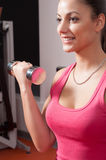 Young woman exercising with weights Royalty Free Stock Photo