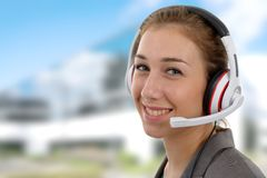 Beautiful smiling young woman with a headset Stock Photos