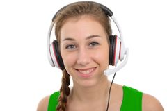 Beautiful smiling young woman with a headset, on white Royalty Free Stock Images