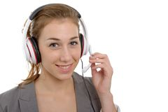 Beautiful smiling young woman with a headset, on white Royalty Free Stock Photo