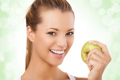 Beautiful smiling young woman holding apple Royalty Free Stock Image