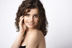 Beautiful smiling young woman. Isolated over white Stock Photo