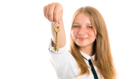 Beautiful smiling young woman with keys from an apartment or house in the hands Stock Images