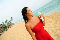 Beautiful smiling young woman with laptop on beach Stock Photography