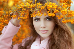 Beautiful smiling young woman over autumn yellow park, beauty po Royalty Free Stock Photos