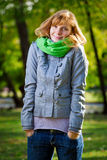Beautiful smiling young woman at park Royalty Free Stock Photo