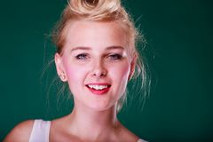 Beautiful smiling young woman with pin up hair stock photography