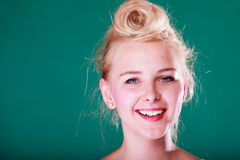 Beautiful smiling young woman with pin up hair. Hairstyling, feminity, female beauty concept. Beautiful smiling teenager young woman with pin up hair. Studio stock photos