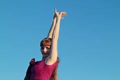 Beautiful smiling young woman in pink dress posing Stock Photo