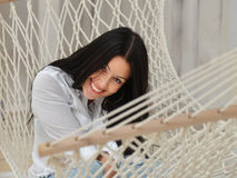 Beautiful smiling  young woman relaxing in hammock at home Royalty Free Stock Photos