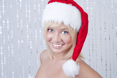 Beautiful smiling young woman in Santa Claus hat Stock Images