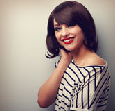 Beautiful smiling young woman with short hair style. Vintage por Royalty Free Stock Image