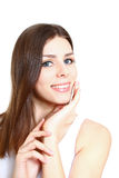 Beautiful smiling young woman stroking her clean beauty face - i Royalty Free Stock Image