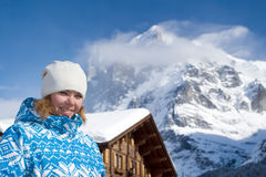 Beautiful smiling young woman. Swiss alps Stock Photography