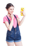 Beautiful smiling young woman taking selfie picture Royalty Free Stock Photos