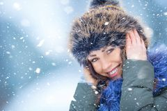 Beautiful smiling young woman in warm clothing. The concept of p Stock Images