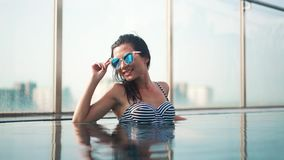 Beautiful smilling girl in sunglasses stock footage