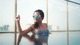 Beautiful smilling woman in sunglasses stock video footage