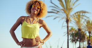 Beautiful Smilng Girl With Afro Haircut. Standing With Her Hands on Hips. Exotic Outdoors on Slow Motion Video stock video footage