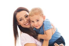 Mom always loves you. Beautiful smimling young mother with her toddler son real family royalty free stock photos