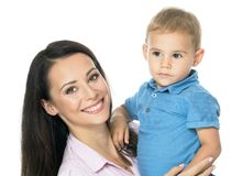 Mom always loves you. Beautiful smimling young mother with her toddler son real family stock image
