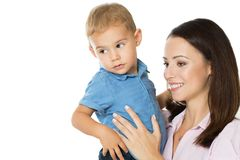 Mom always loves you. Beautiful smimling young mother with her toddler son real family stock images